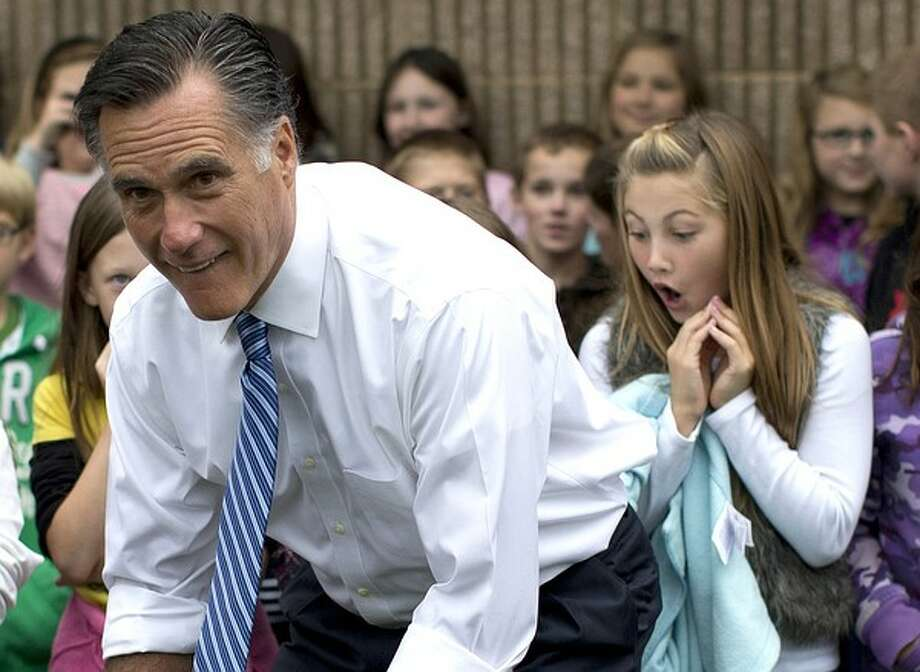 Republican presidential candidate, former Massachusetts Gov. Mitt Romney poses for photographs with students of Fairfield Elementary School, Monday, Oct. 8, 2012, in Fairfield, Va. Photo: Evan Vucci, AP / AP
