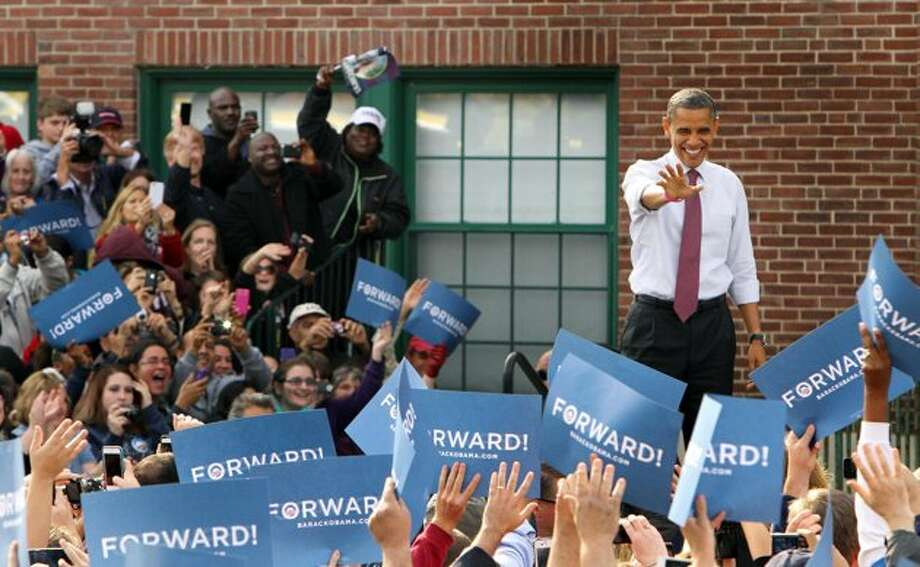 President Barack Obama arrives for a campaign event at Elm Street Middle School, Saturday, Oct. 27, 2012 in Nashua, N.H.  (Jim Cole / AP Photo)