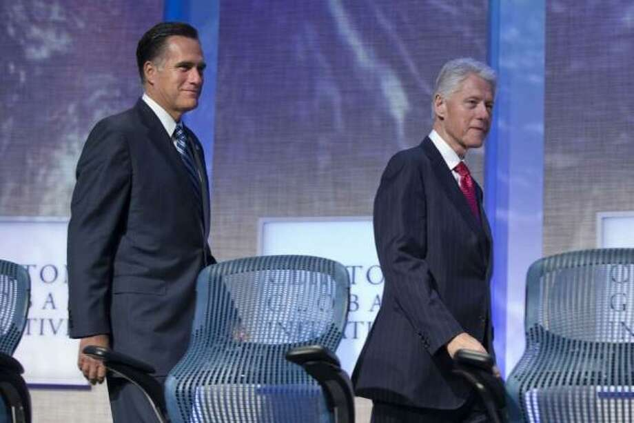 GOP presidential candidate, former MA Governor Mitt Romney appears on stage with former Pres Bill Clinton at Clinton's Global Initiative Convention in New York City. Sept 25, 2012 (Evan Vucci / AP Photo)