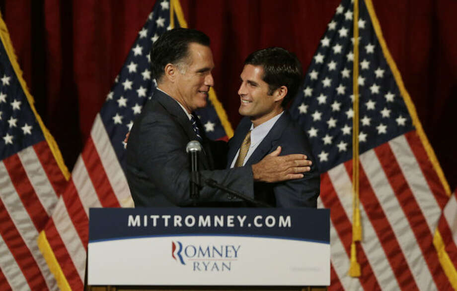 Republican presidential candidate and former Massachusetts Gov. Mitt Romney, left, is introduced by his son Matt before he speaks at a campaign fundraising event in Del Mar, Calif., Saturday, Sept. 22, 2012. (Charles Dharapak / AP Photo)