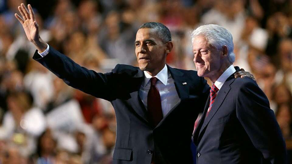 President Barack Obama waves after Former President Bill Clinton spoke at the Democratic National Co