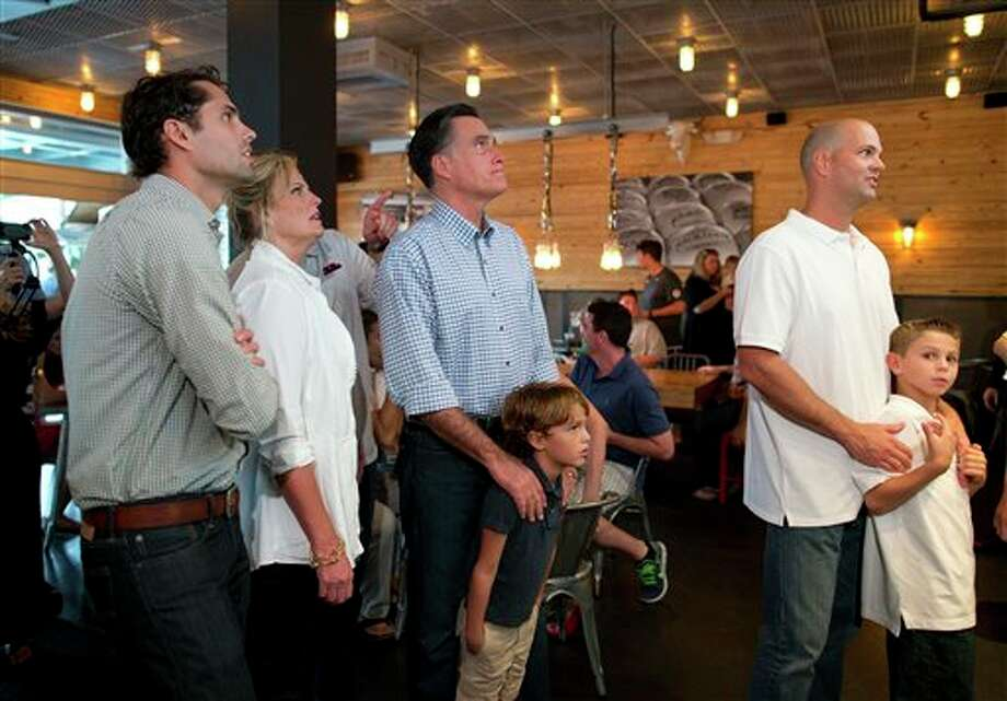 Republican presidential candidate, former Massachusetts Gov. Mitt Romney, third from left, waits in line to order dinner at BurgerFi on Sunday, Oct. 21, 2012 in Delray Beach, Fla.  From left, son Craig, wife Ann, Romney, and grandson Parker. Photo: Evan Vucci, AP / AP