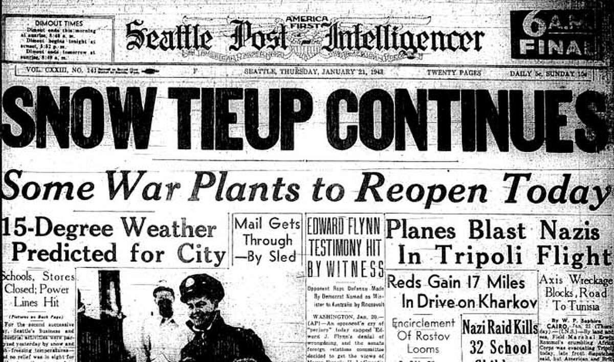 The snowstorm hit Seattle Jan. 19, 1943 and continued for days. The image on this front page of the postman sledding with a 12-year-old girl has been saved at the Museum of History and Industry.