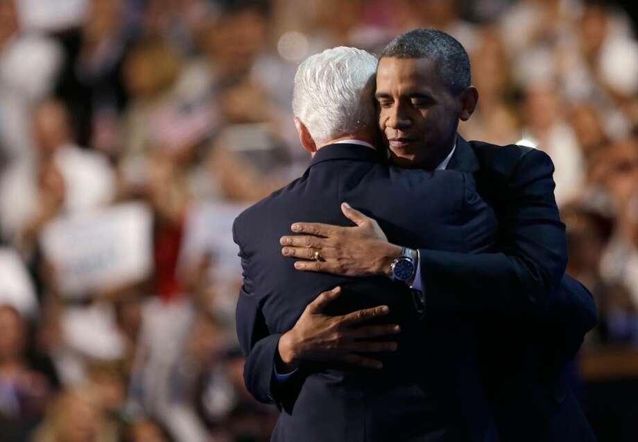 President Barack Obama hugs former President Bill Clinton after his speech in Charlotte on September 5, 2012. (David Goldman / AP Photo)