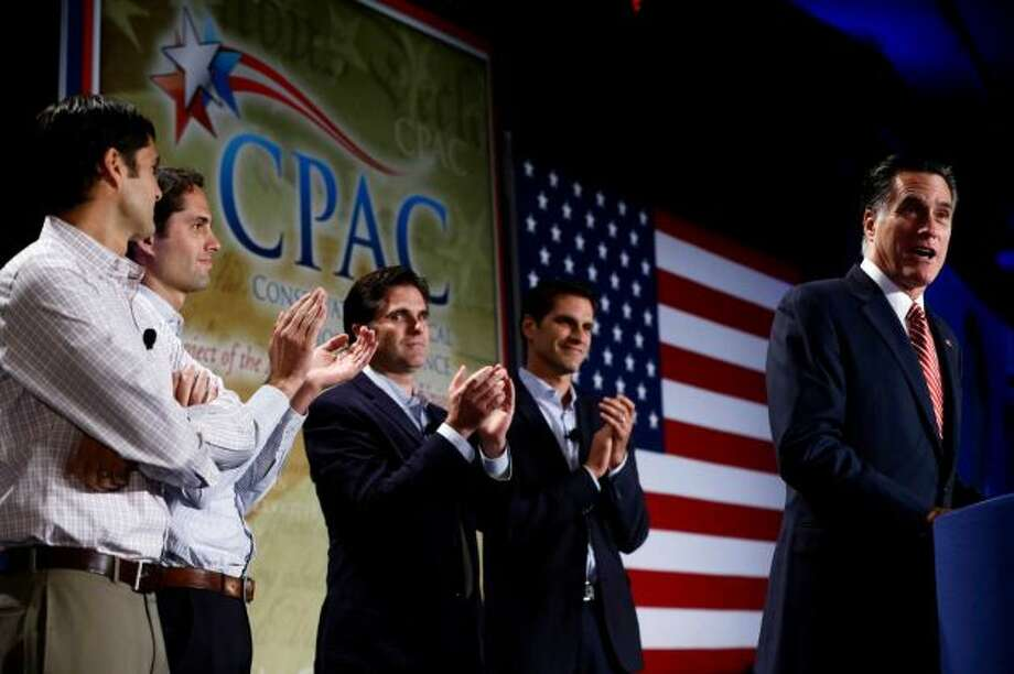 Republican presidential candidate, former Massachusetts Gov. Mitt Romney speaks at a Colorado Conservative Political Action Committee (CPAC) meeting in Denver, Thursday, Oct. 4, 2012. At rear are sons Matt, Craig, Tagg, and Josh Romney.  (Charles Dharapak / AP Photo)