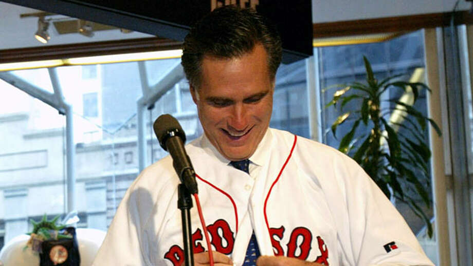 Mitt Romney, wears a Boston Red Sox jersey, at a hotel in New York. (Gregory Bul / AP Photo)