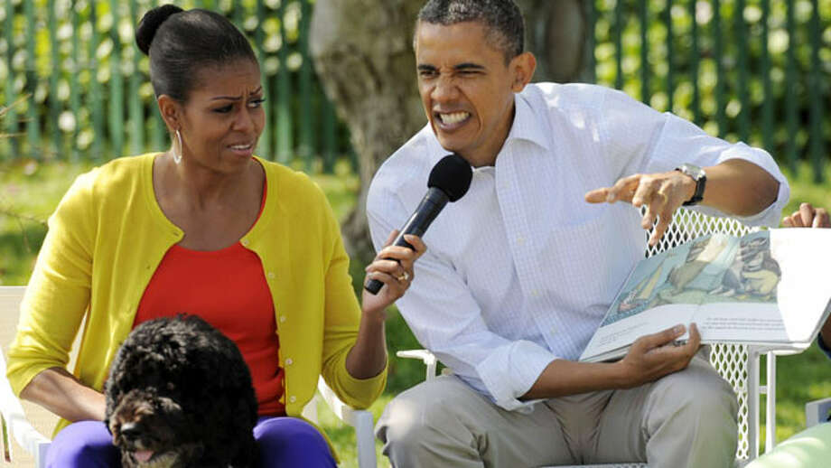 "Barack Obama reads ""Where the Wild Things Are"", by Maurice Sendak, with Michelle and Malia Obama at the annual Easter Egg Roll in Washington D.C on April 9, 2012. (Rex Features / AP Photo)"