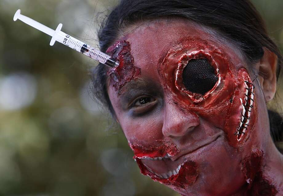 Adverse reaction to your flu shot?Doctors say this complication is extremely unlikely - unless you're attending the Zombie Walk in Mexico City. Photo: Marco Ugarte, Associated Press