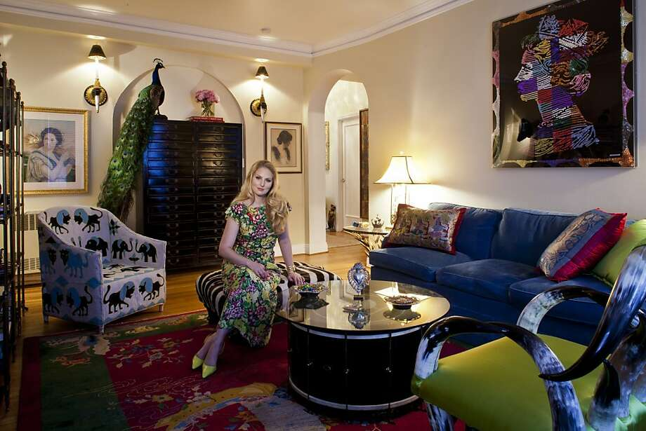 Amanda Miller surrounds herself with vibrant decor from around the world. Her closet, below, is full of colorful vintage pieces from a number of designers - all purchased on eBay. Photo: Peter DaSilva, Special To The Chronicle