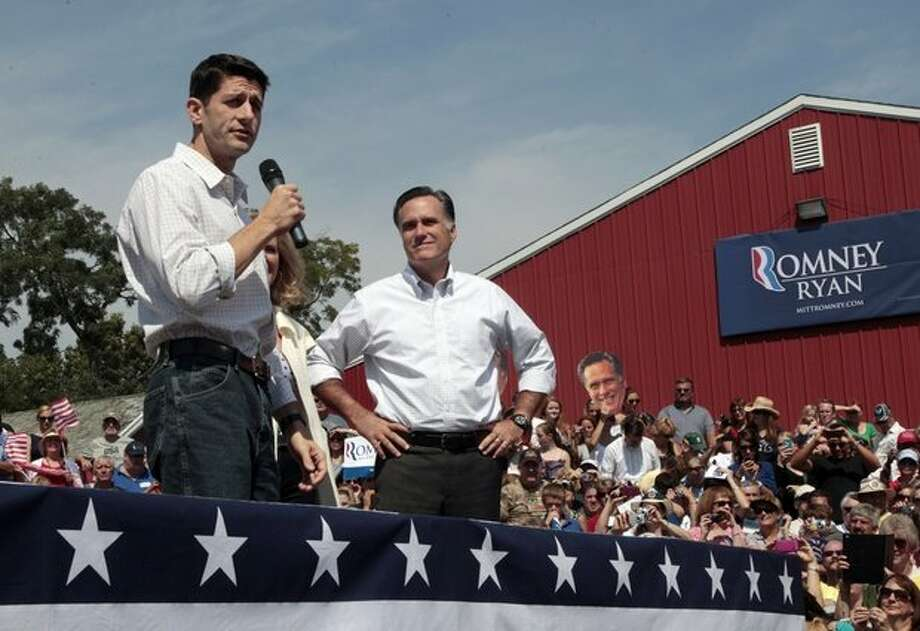 Republican presidential candidate, former Massachusetts Gov. Mitt Romney, right, listens and Republican vice presidential candidate, Rep. Paul Ryan, R-Wis., speaks during a campaign event at the Long Family Farm, Orchard & Cider Mill, Friday, Aug. 24, 2012 in Commerce, Mich. (AP Photo)