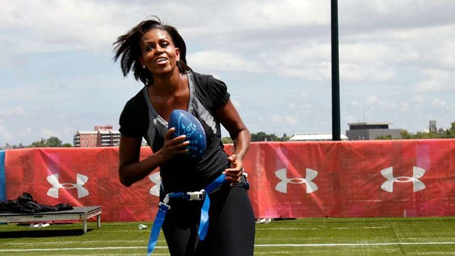 First lady Michelle Obama turns and runs after catching a pass while participating in the Let's Move! Campaign and the NFL's Play 60 Campaign festivities with area youth in New Orleans in this Sept. 8, 2010 file photo.