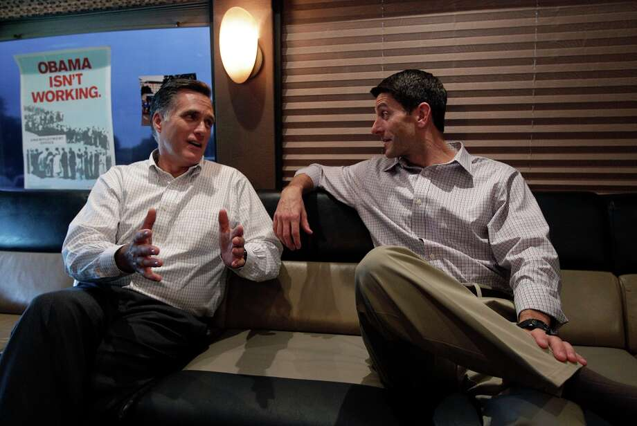 Republican presidential candidate, former Massachusetts Gov. Mitt Romney, left and running mate Rep. Paul Ryan, R-Wis., talk in the campaign bus before an event at the Waukesha county expo center, Sunday, Aug. 12, 2012 in Waukesha, Wis. Photo: AP