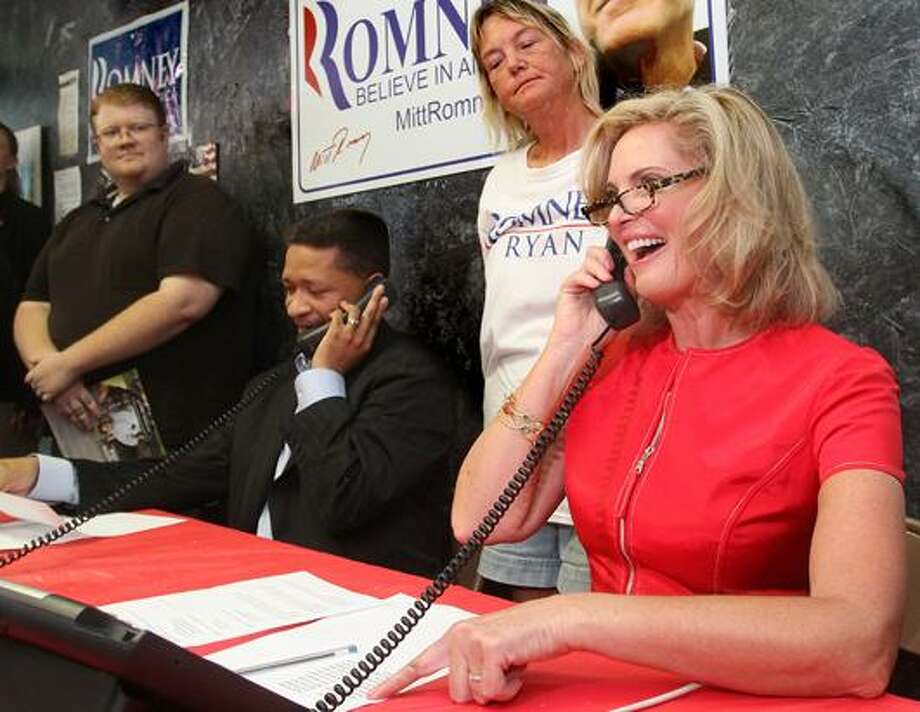 Ann Romney works the phones during a surprise appearance at the Republican Party of Orange County Victory Office on Saturday, Oct. 6, 2012 in Orlando, Fla. (Joe Burbank / AP Photo)