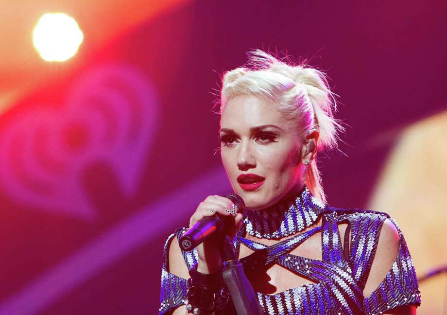 "FILE - This Sept. 21, 2012 file photo originally released by Clear Channel shows Gwen Stefani of No Doubt performing at the 2012 iHeartRadio Music Festival at the MGM Grand Garden Arena in Las Vegas, Nev. No Doubt has pulled its new cowboys and Indians-themed music video and is apologizing to Native Americans and others who were offended by the clip. The band posted on its website Saturday, Nov. 3, that the video for ""Looking Hot"" was ""never to offend, hurt or trivialize Native American people."" The video features Gwen Stefani and bandmate Tony Kanal dressed in traditional Native American clothes, while Adrian Young and Tom Dumont are in cowboy get-ups with guns. Stefani also rides and horse and sings in a tepee in the clip, which includes a fire-burning dance scene with others dressed in Native American clothes.  (AP Photo/Clear Channel, Andrew Swartz) Photo: Andrew Swartz"