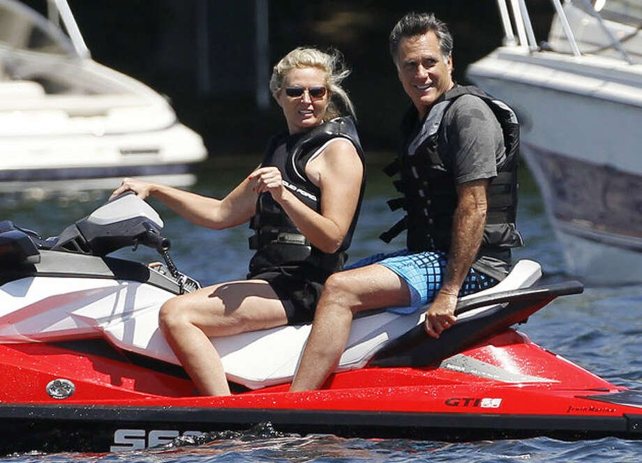 Republican presidential candidate, former Massachusetts Gov. Mitt Romney and wife Ann Romney jet ski on Lake Winnipesaukee in Wolfeboro, N.H., Monday, July 2, 2012, where Romney has a vacation home.  (Charles Dharapak / AP Photo)