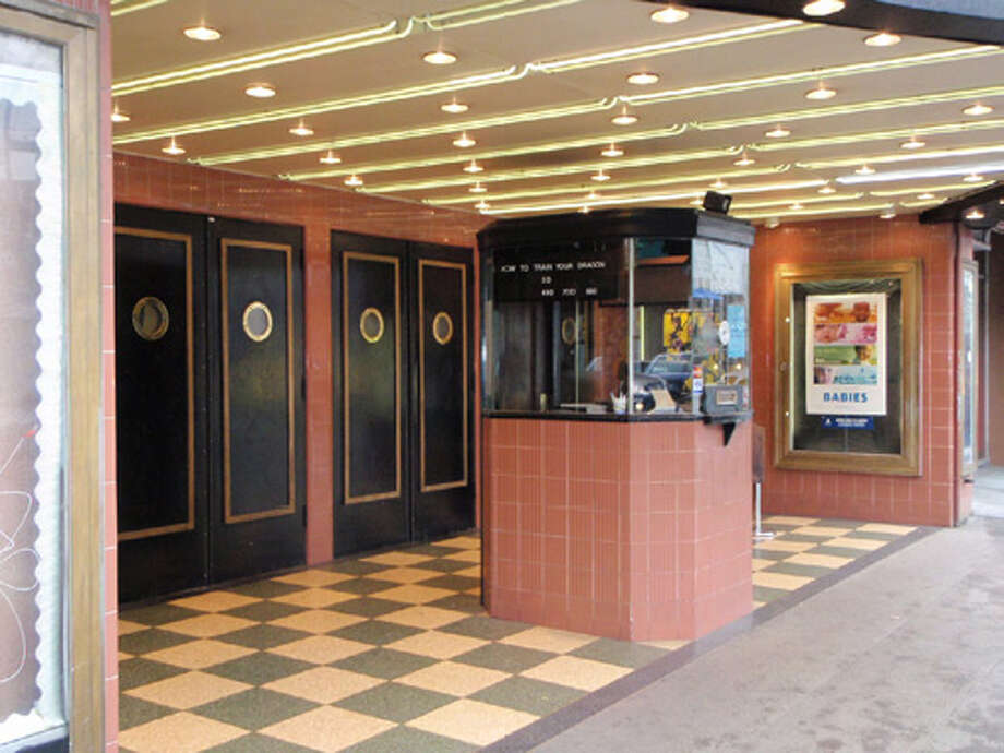 The theater's old-school ticket booth still stands. The front-door, boat-like port windows were added in 1981, when the Landmark Theater Corporation took over operations and did a big remodel. Before that, the Neptune struggled in the '70s and was a porn theater. (Larry E. Johnson) Photo: /