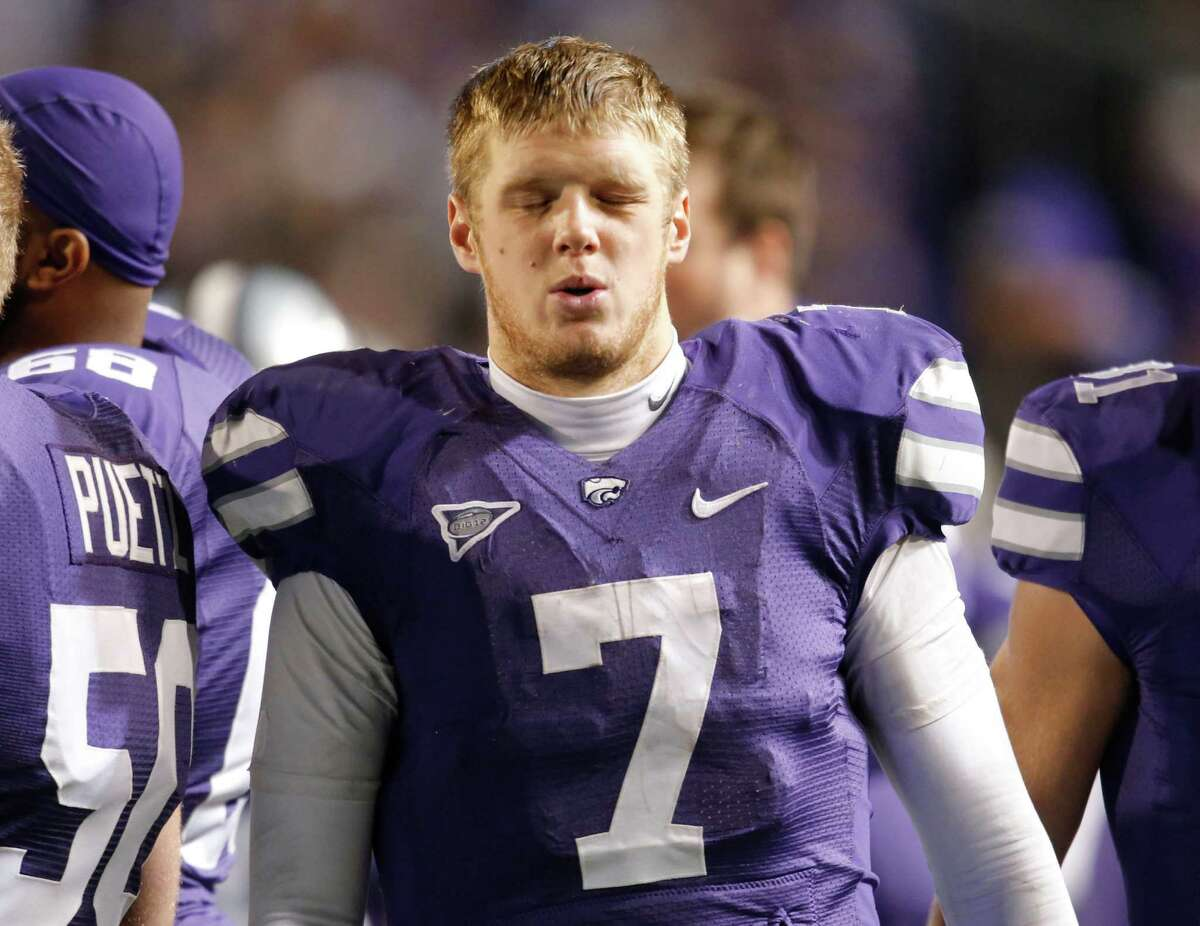 Kansas State quarterback Collin Klein (7) winces on the sideline after leaving the game in the third quarter against Oklahoma State at Bill Snyder Family Stadium in Manhattan, Kansas, on Saturday, November 3, 2012. (Bo Rader/Wichita Eagle/MCT)