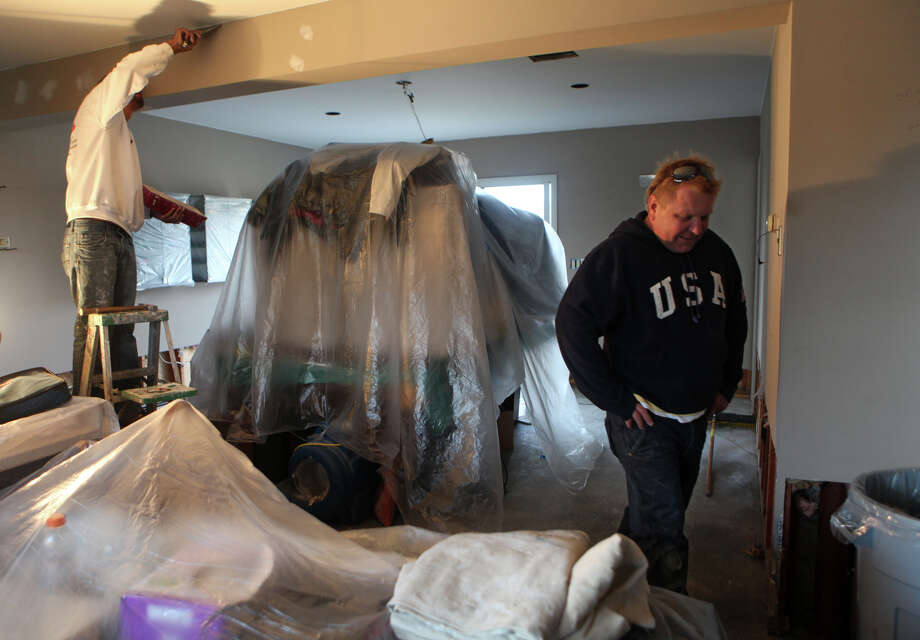 Jeff Valko, right, stands in the living room of his home on Fairfield Beach Road, which was damaged in storm Sandy, on Monday, November 5, 2012. Valko's first floor was destroyed. Photo: BK Angeletti, B.K. Angeletti / Connecticut Post freelance B.K. Angeletti