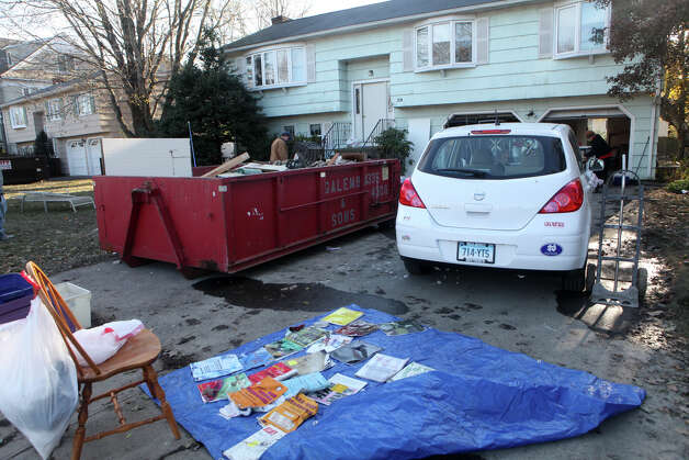 Birch Road home owners begin to clean up after storm Sandy on Monday, November 5, 2012 in Fairfield, Conn. Photo: BK Angeletti, B.K. Angeletti / Connecticut Post freelance B.K. Angeletti