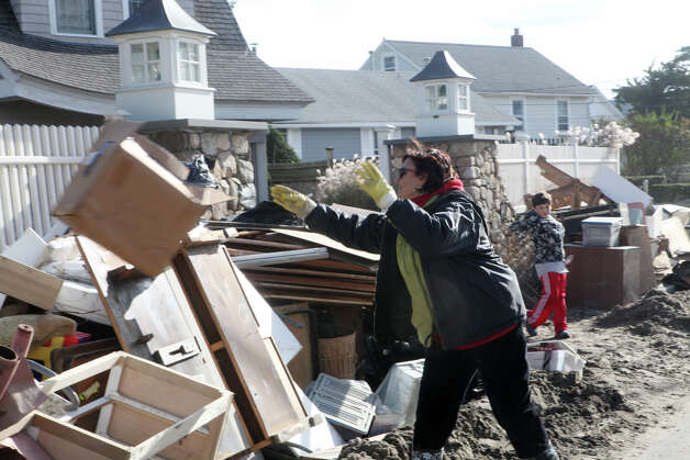 Fairfield Beach Road homeowners begin to clean up after storm Sandy on Monday, November 5, 2012 in Fairfield, Conn. Photo: BK Angeletti, B.K. Angeletti / Connecticut Post freelance B.K. Angeletti