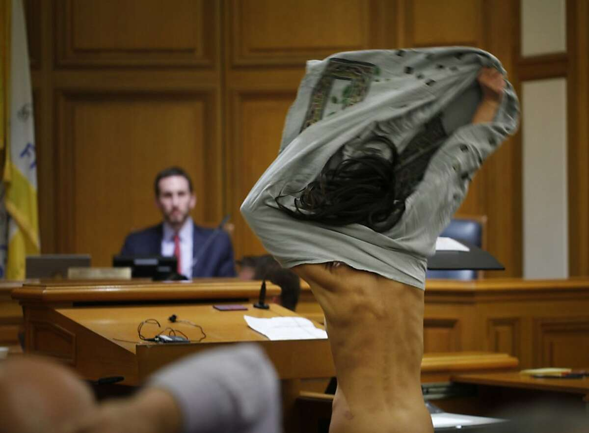 During a public hearing for legislation proposed by Supervisor Scott Wiener that would ban nudity on public streets, Gypsy Taub takes her clothes off during the public comment session of the hearing in San Francisco City Hall on Monday Nov. 5, 2012 in San Francisco, Calif.