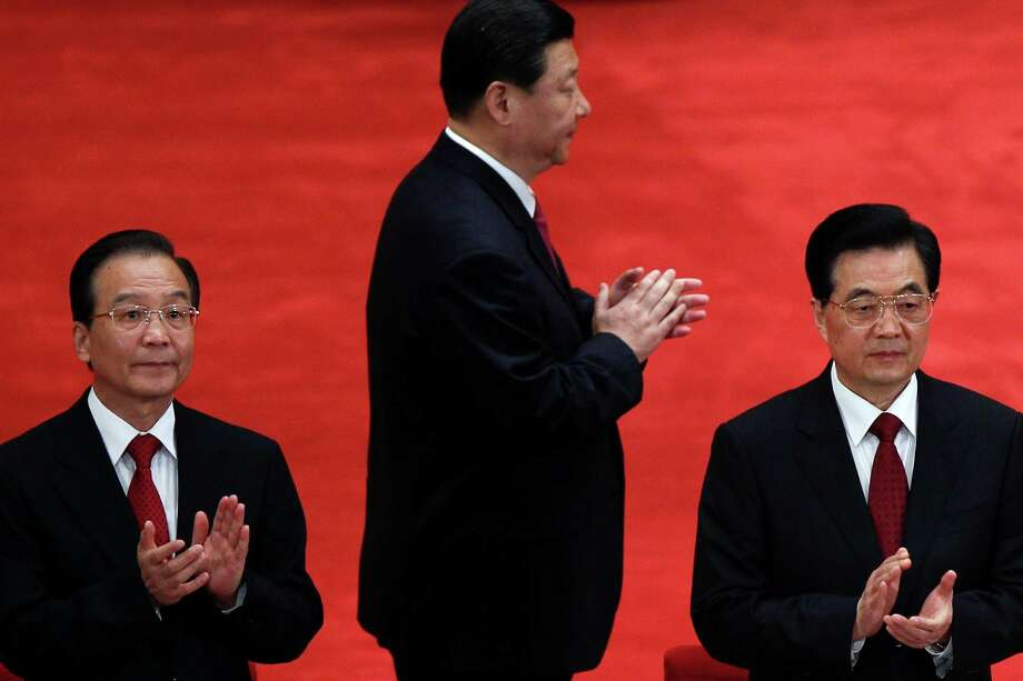 Chinese Vice President Xi Jinping (center), President Hu Jintao (right) and Premier Wen Jiabao clap together while arriving for a conference. In China and many places elsewhere, democracy is elusive. Photo: Alexander F. Yuan, Associated Press / AP