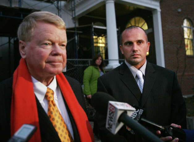 Defense attorney Hugh Keefe, left, and former Milford police officer Jason Anderson leave Milford Superior Court on Monday, November 5, 2012. Anderson is on trial for two counts of manslaughter for his involvement in an automobile crash that killed two Orange teenagers. The jury is still deliberating the verdict in the case. Photo: Brian A. Pounds / Connecticut Post