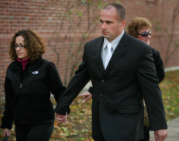 Former Milford police officer Jason Anderson and his wife walk to Milford Superior Court where a jury is deliberating his manslaughter case on Monday, November 5, 2012. Photo: Brian A. Pounds / Connecticut Post