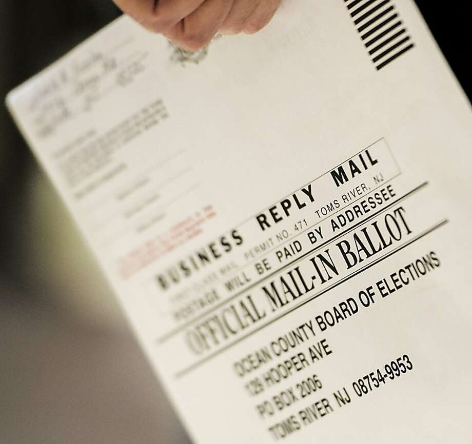 Displaced voters have to follow up online votes with mail-in ballots. Photo: Paul J. Richards, AFP/Getty Images