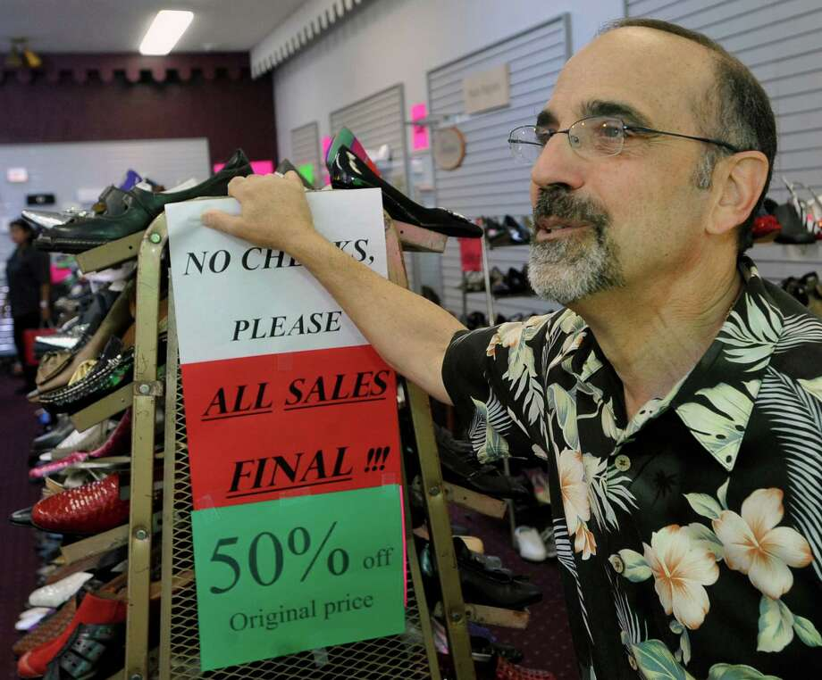 Mike Spector talks about why he is shutting down the store Monday afternoon November 5, 2012.  He said it was a hard decision, but he wants to do do more things with his family.  Guarantee Shoe Store, which has been located at the Gateway Shopping Center for the past 40 years, is closing it's doors.  The family owned business has been in existence for 78 years with several stores located throughout the region over the years.  Dave Ryan/The Enterprise Photo: Dave Ryan