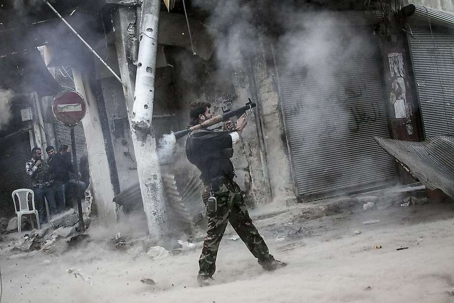In this Sunday, Nov. 04, 2012 photo, a rebel fighter aims a shoulder-fired missile toward a building where Syrian troops loyal to President Bashar Assad are hiding while they attempt to gain terrain against the rebels during heavy clashes in the Jedida district of Aleppo, Syria. The uprising against Assad started with peaceful demonstrations in March last year, but has since morphed into a bloody civil war. Activists say more than 36,000 people have been killed in 19 months of fighting. Photo: Narciso Contreras, Associated Press