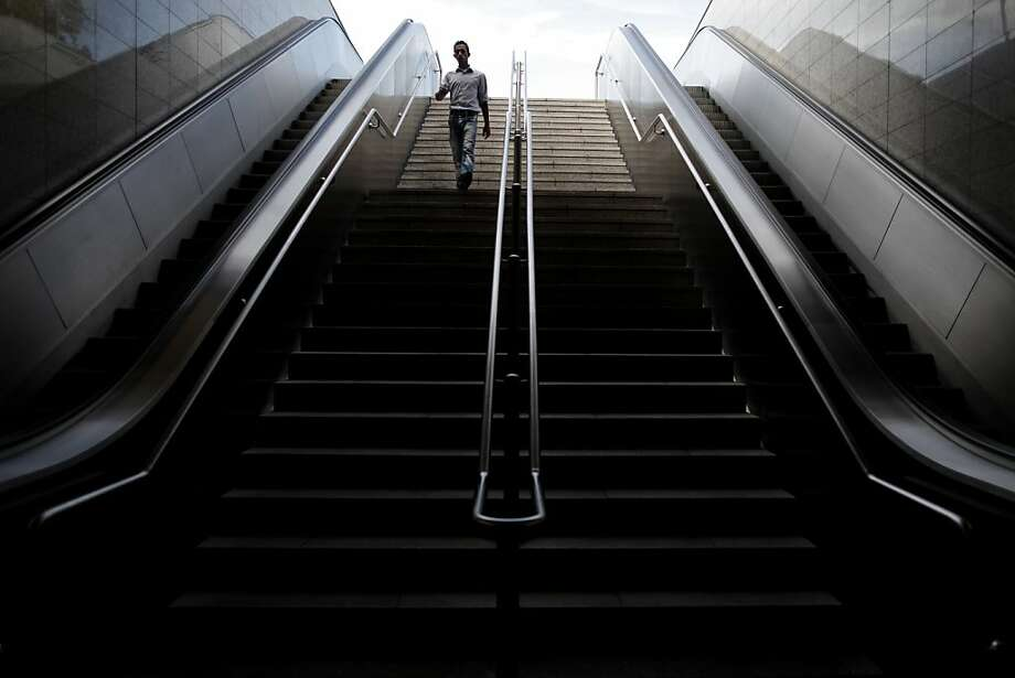 A commuter walks down stairs of a closed  metro station during a 24-hour strike in Athens, on Monday, Nov. 5, 2012. Greece is facing three days of escalating anti-austerity strikes, with state hospital doctors, taxi drivers, transport workers and journalists walking off the job.The strikes come as the wobbly coalition government prepares to present another austerity package in Parliament later Monday.(AP Photo/Petros Giannakouris) Photo: Petros Giannakouris, Associated Press