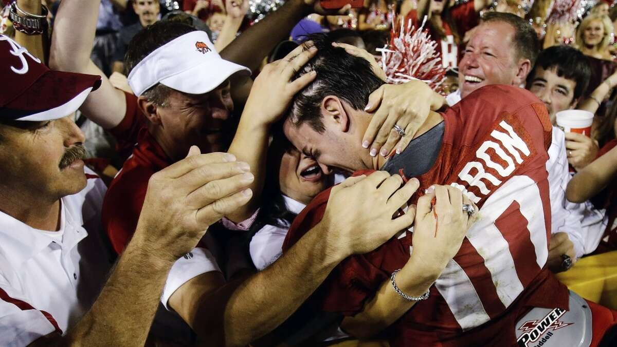 BEST: BCS national championship game (Alabama vs. Notre Dame, Jan. 7) -- What could be better than two tradition-steeped rivals playing for all of the credit cards, as Brent Musburger will say? Alabama quarterback AJ McCarron (10) is congratulated by the fans after defeating LSU 21-17 on Nov. 3, 2012. Bill Haber/Associated Press