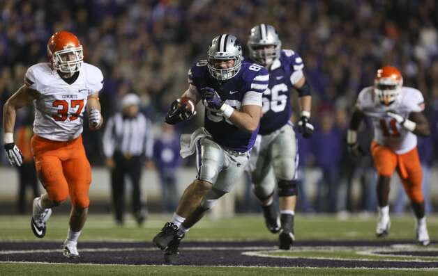 Tight end Travis Tannahill #80 of the Kansas State Wildcats runs for a first down against the Oklahoma State Cowboys  in the fourth quarter at Bill Snyder Family Football Stadium on November 3, 2012 in Manhattan, Kansas. (Ed Zurga/Getty Images) (Getty Images)