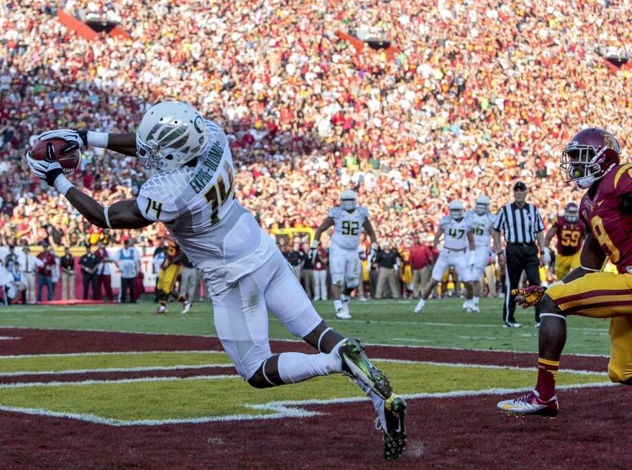Oregon cornerback Ifo Ekpre-Olomu (14) intercepts a pass in the back of the end zone during the first half of an NCAA college football game against Southern California, Saturday, Nov. 3, 2012, in Los Angeles. (AP Photo/Bret Hartman) (Associated Press)