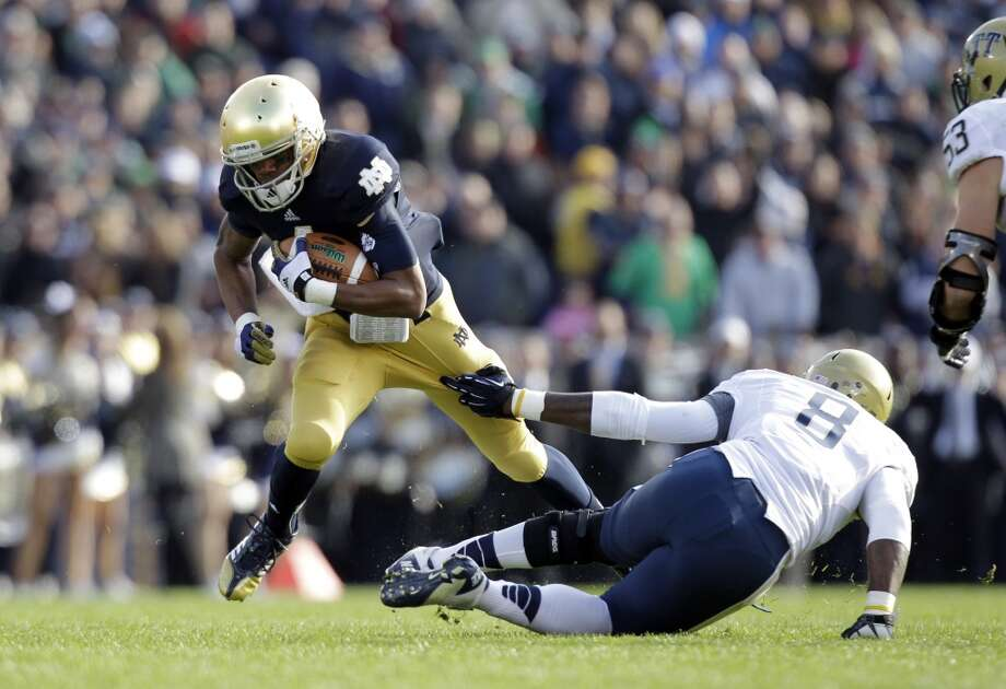 Notre Dame running back George Atkinson III tries to get past Pittsburgh linebacker Todd Thomas during the first half of an NCAA college football game in South Bend, Ind., Saturday, Nov. 3, 2012. (AP Photo/Michael Conroy) (Associated Press)