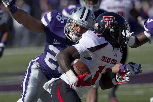 Kansas State linebacker Seth Childs (26) tackles Texas Tech's Jackson Grant (11) during the first half of an NCAA college football game in Manhattan, Kan., Saturday, Oct. 27, 2012. (AP Photo/Orlin Wagner) (Associated Press)