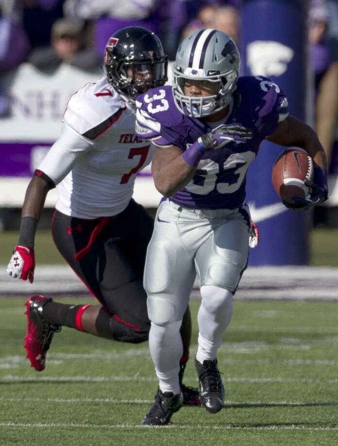 Kansas State running back John Hubert runs away from Texas Tech linebacker Will Smith (7) during the first half of an NCAA college football game in Manhattan, Kan., Saturday, Oct. 27, 2012. Kansas State defeated Texas Tech 55-24. (AP Photo/Orlin Wagner) (Associated Press)