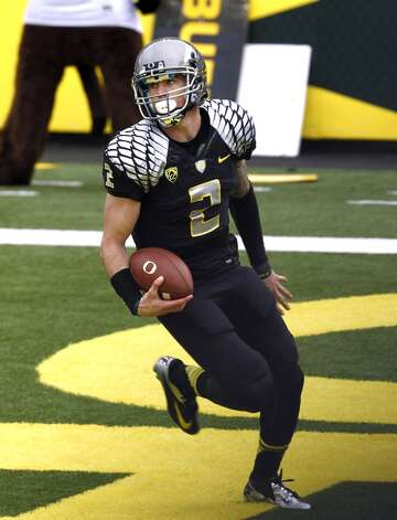 Oregon quarterback Bryan Bennett scores during their NCAA college football game against Colorado in Eugene, Ore., Saturday, Oct. 27, 2012. (AP Photo/Don Ryan) (Associated Press)