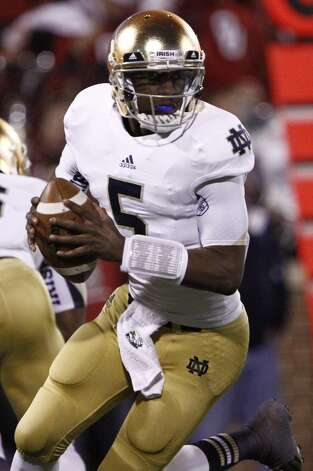 Notre Dame quarterback Everett Golson (5) looks to pass against Oklahoma during the second quarter of an NCAA college football game in Norman, Okla., Saturday, Oct. 27, 2012.  Notre Dame won 30-13.  (AP Photo/Alonzo Adams) (Associated Press)