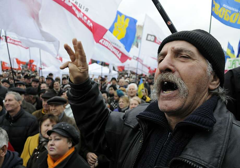 Ukrainian opposition party supporters protest at the Central Elections Commission building in Kiev. Photo: Sergei Chuzavkov, Associated Press