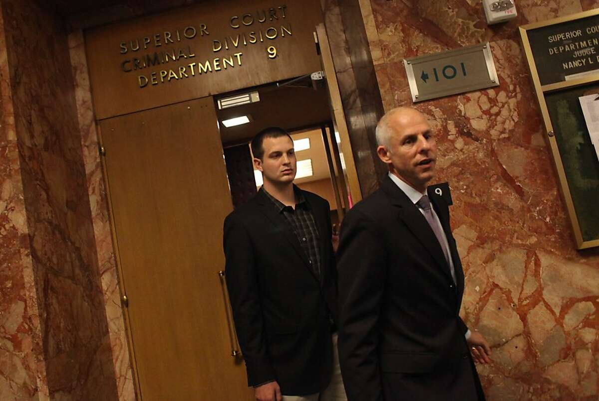 Gregory Graniss (l to r), who allegedly smashed a Muni bus windshield after the San Francisco Giants won the World Series, is seen leaving his arraignment with attorney Douglas Rappaport at the Hall of Justice on Monday, November 5, 2012 in San Francisco, Calif.
