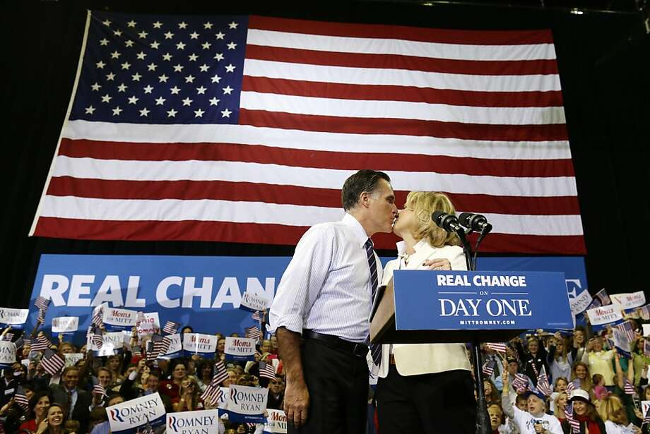 Republican candidate Mitt Romney kisses his wife, Ann, as they take the stage at a campaign rally at the Patriot Center in Fairfax, Va. Photo: Charles Dharapak, Associated Press