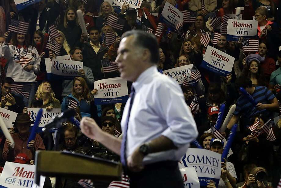 The crowd watches Republican nominee Mitt Romney at George Mason University, in Fairfax, Va. Photo: Charles Dharapak, Associated Press