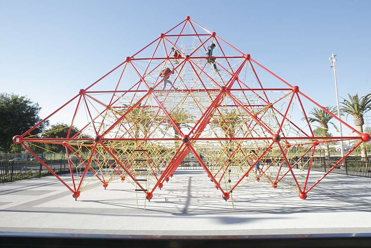 Children play inside a pyramid playset in Union City, Calif. on Sunday, November 4, 2012.