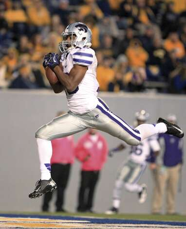 Kansas State wide receiver Tyler Lockett catching a touchdown pass during the third quarter of an NCAA college football game against West Virginia in Morgantown, W.Va. Kansas State is ranked No. 4 and just maybe barreling toward a spot in the BCS title game.(AP Photo/Christopher Jackson, File) (Associated Press)