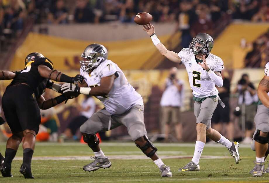 Quarterback Bryan Bennett #2 of the Oregon Ducks throws a pass during the college football game against the Arizona State Sun Devils at Sun Devil Stadium on October 18, 2012 in Tempe, Arizona. The Ducks defeated the Sun Devils 43-21. (Photo by Christian Petersen/Getty Images) (Getty Images)
