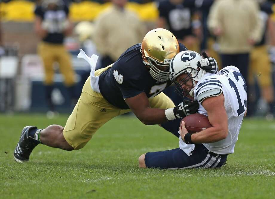 Stephon Tuitt #7 of the Notre Dame Fighting Irish sacks Riley Nelson #13 of the BYU Cougars at Notre Dame Stadium on October 20, 2012 in South Bend, Indiana.  (Photo by Jonathan Daniel/Getty Images) (Getty Images)