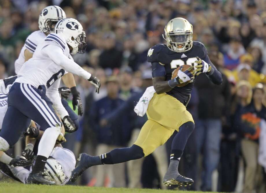 Notre Dame running back Cierre Wood runs against the BYU during the second half of an NCAA college football game in South Bend, Ind., Saturday, Oct. 20, 2012. Notre Dame defeated BYU 17-14. (AP Photo/Michael Conroy) (Associated Press)