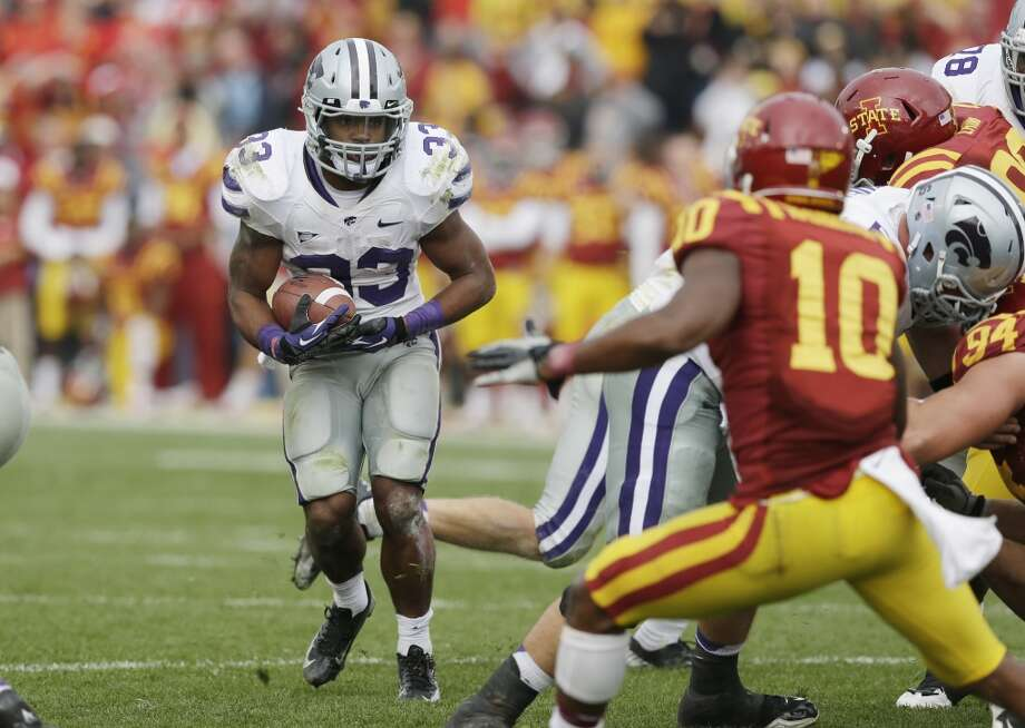 Kansas State running back John Hubert, left, carries the ball during the second half of an NCAA college football game against Iowa State, Saturday, Oct. 13, 2012, in Ames, Iowa. Kansas State won 27-21. (AP Photo/Charlie Neibergall) (Associated Press)